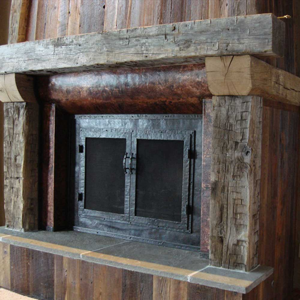 metal-fireplace-mantel-raw-wood