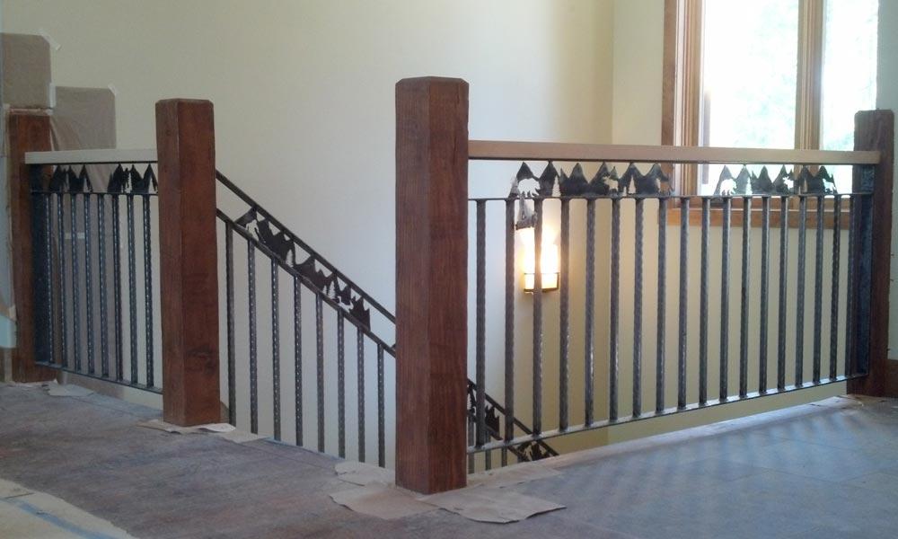mountain-scene-iron-railing-indoor